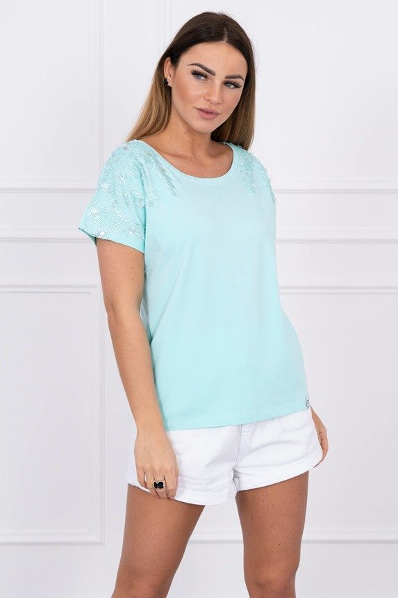 Blouse with the application on the shoulders light mint