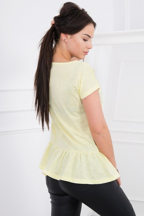 A blouse with a baskina, yellow