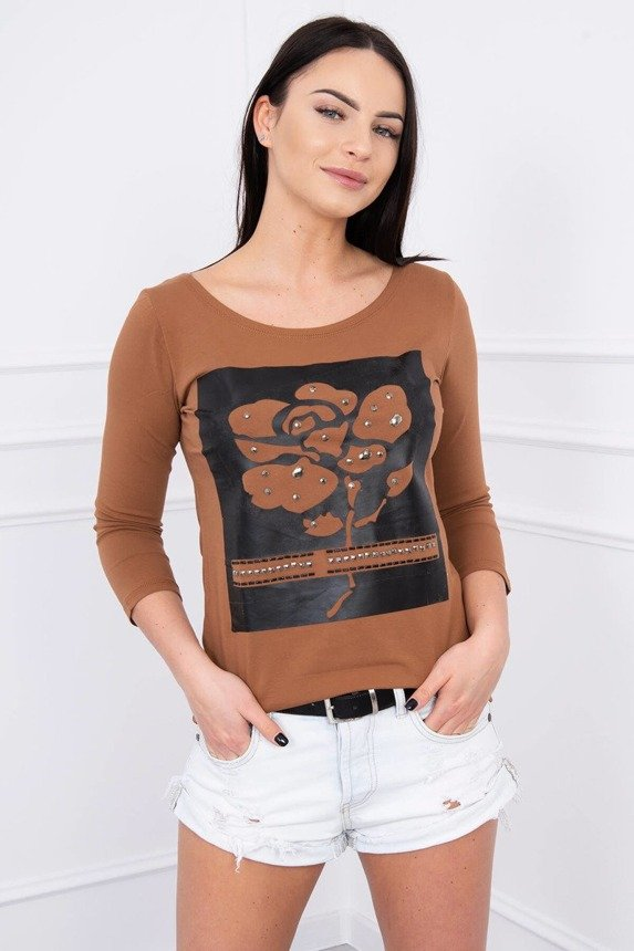 A blouse with a rose and hobnails, brown