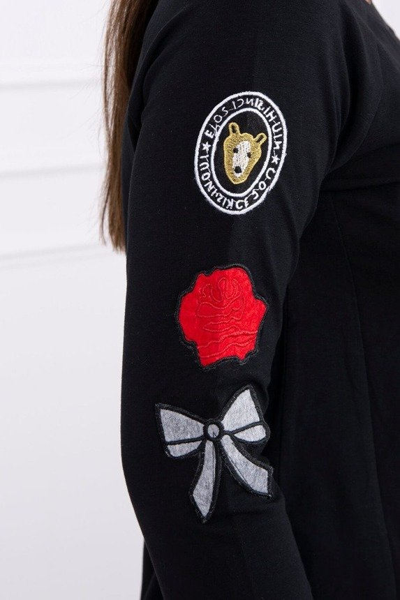 A blouse with emblems on a sleeve, black