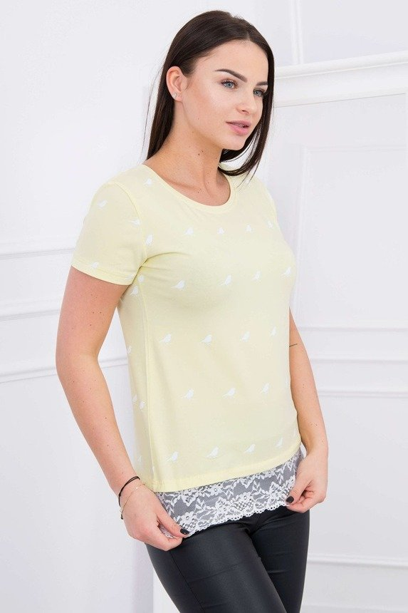 A blouse with little birds and a lace strip, yellow