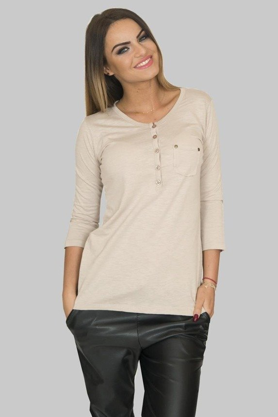 A blouse with little buttons at the neckline, beige
