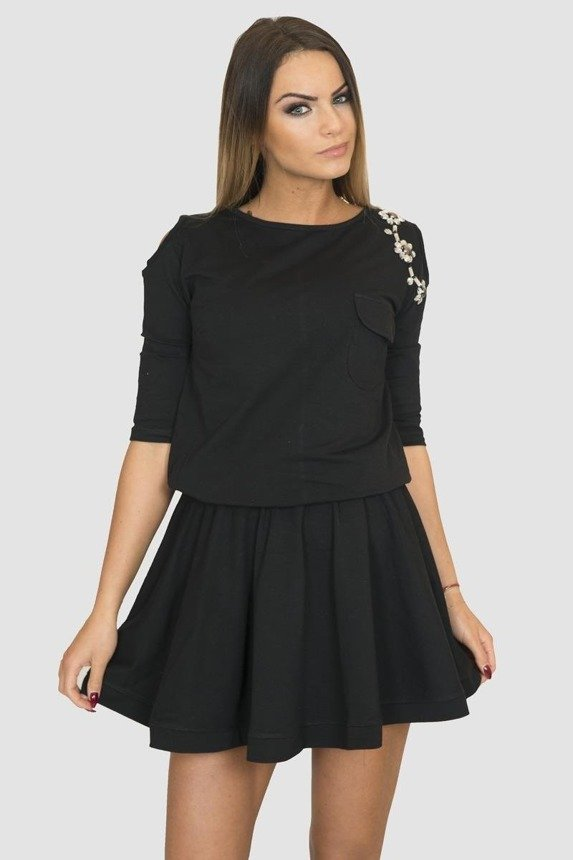 A dress with flowers application at the shoulder, black