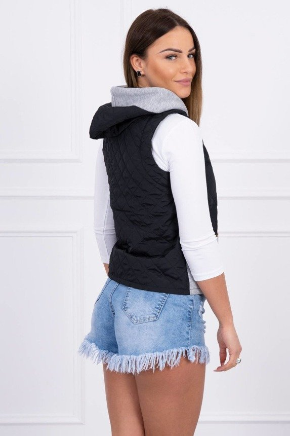 A quilted vest with a hood, black + gray