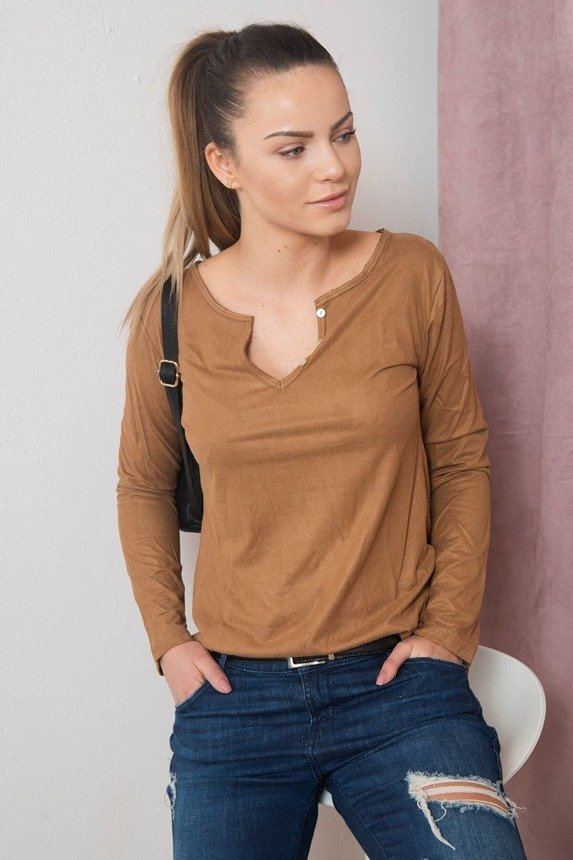 A suede leather blouse with little buttons at the neckline, foxy